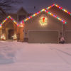 Winter Home with Holiday Lights and Tracks